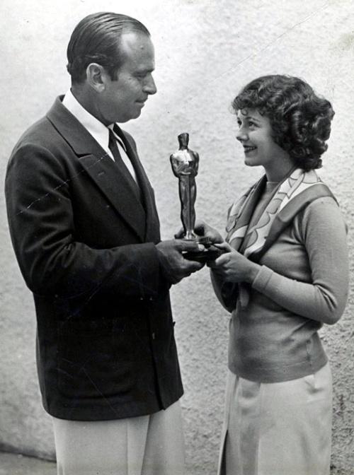 Janet Gaynor receives her Oscar from Douglas Fairbanks.